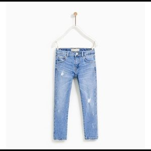 Light washed denim jeans with rhinestone detail